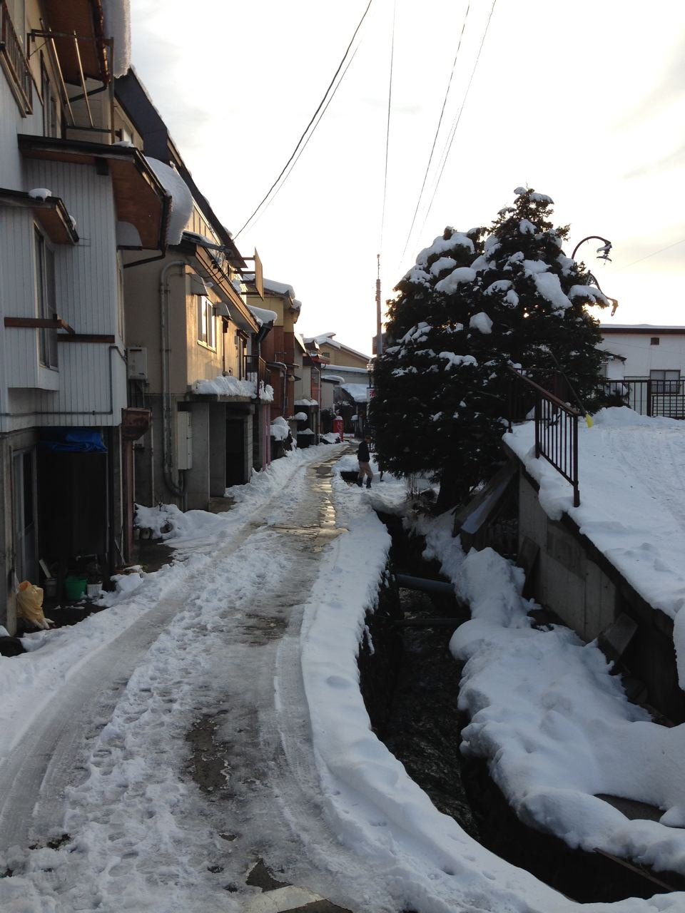 Sun set, small street, snow shovel Nozawa Style