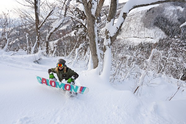 Judita climbs to access an un-riden line in the Nozawa Onsen trees.