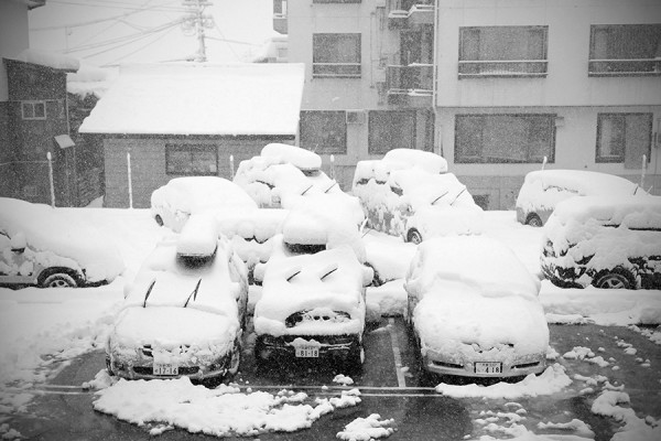 A classic view in the streets of Nozawa Onsen all season long; car mushrooms.