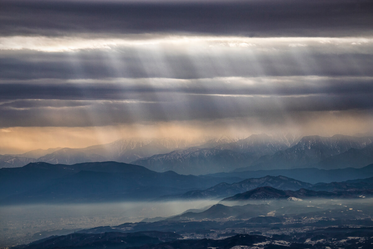 Sunbeams over Nagano and the Japanese Alps. Shot with a mid telephoto from the Skyline double chair.