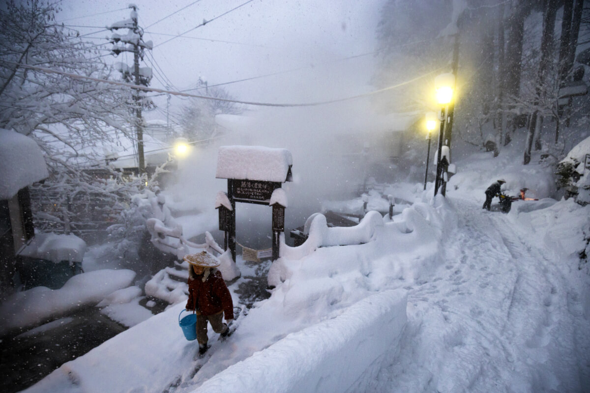 A villager exits the cooking onsen after recent heavy snowfalls