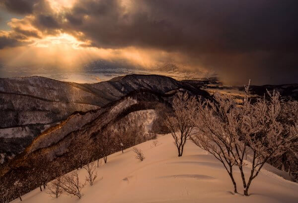 A dramatic sunset over Nozawa Onsen as a heavy snow shower sweeps through.